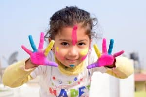 cute child with fingerpaint